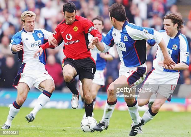 Ryan Giggs of Manchester United runs at Michael Gray Markus Babbel and NilsEric Johansson of Blackburn Rovers during the FA Barclaycard Premiership...