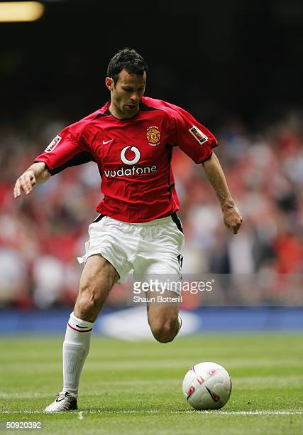 Ryan Giggs of Manchester United runs with the ball during the 123rd FA Cup Final between Manchester United and Millwall held at The Millennium...