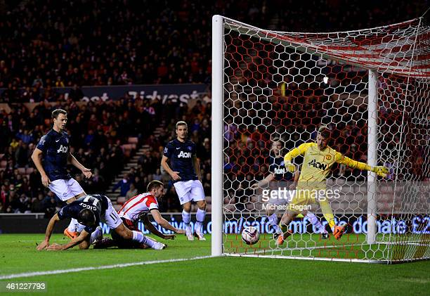 Ryan Giggs of Manchester United scores an own goal for Sunderlan's first goal during the Capital One Cup SemiFinal first leg match between Sunderland...