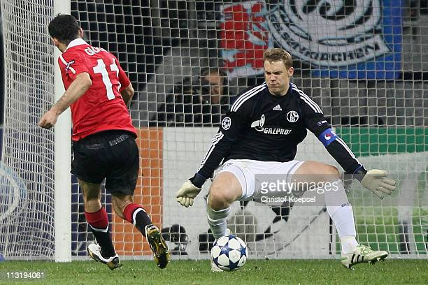 Ryan Giggs of Manchester United scores the first goal against Manuel Neuer of Schalke during the UEFA Champions League semi final first leg match...
