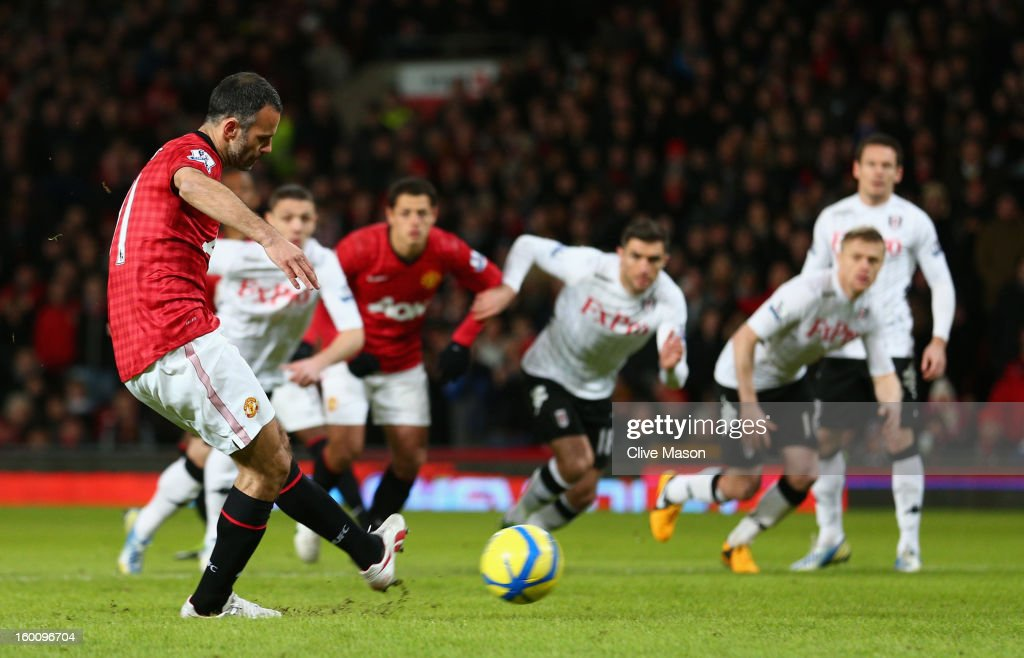 Ryan Giggs of Manchester United scores the opening goal from a penalty kick during the FA Cup with Budweiser Fourth Round match between Manchester United and Fulham at Old Trafford on January 26, 2013 in Manchester, England.