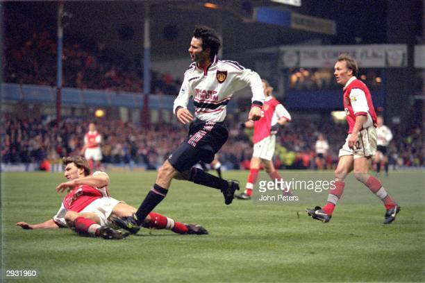 Ryan Giggs of Manchester United scores the winning goal for Manchester United in extra time during the FA Cup semi-final between Arsenal v Manchester...