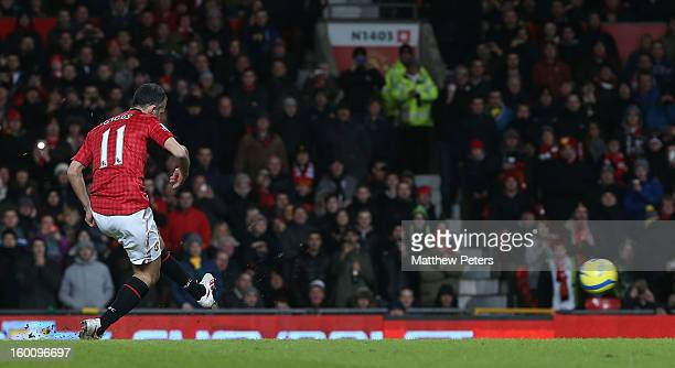 Ryan Giggs of Manchester United scores their first goal during the FA Cup Fourth Round match between Manchester United and Fulham at Old Trafford on...
