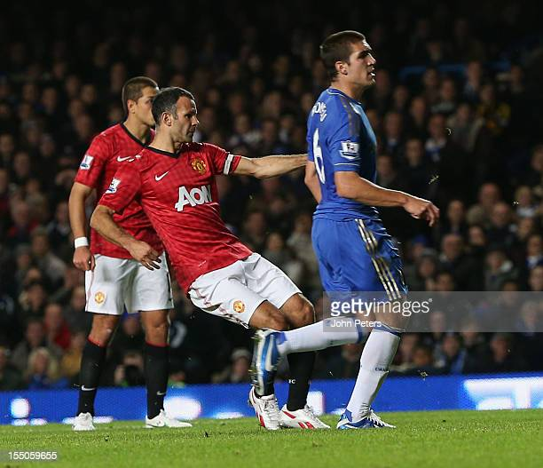 Ryan Giggs of Manchester United scores their first goal during the Capital One Cup Fourth Round match between Chelsea and Manchester United at...