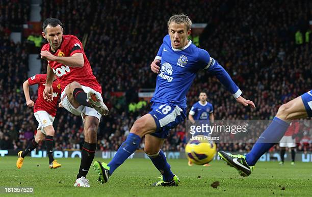 Ryan Giggs of Manchester United scores their first goal during the Barclays Premier League match between Manchester United and Everton at Old...