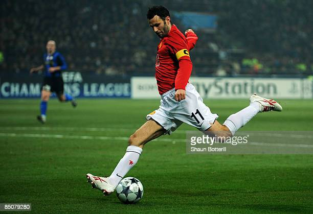 Ryan Giggs of Manchester United shoots on goal during the UEFA Champions League Round of Last 16 First Leg match between Inter Milan and Manchester...