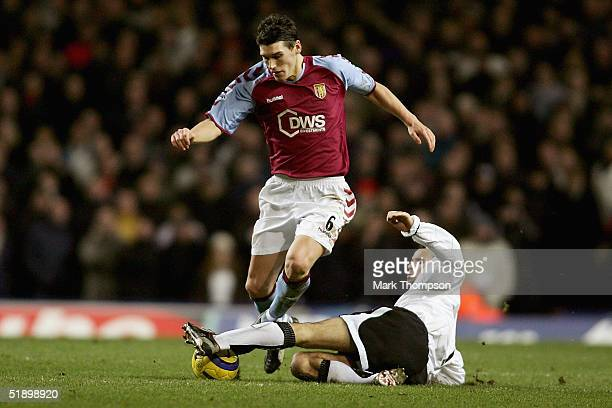 Ryan Giggs of Manchester United tackles Gareth Barry of Aston Villa during the FA Barclays Premiership match between Aston Villa and Manchester...