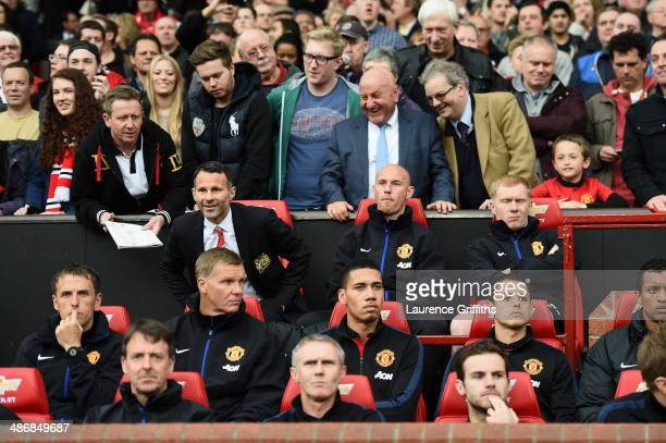 Ryan Giggs of Manchester United takes his seat in the dug out during the Barclays Premier League match between Manchester United and Norwich City at...