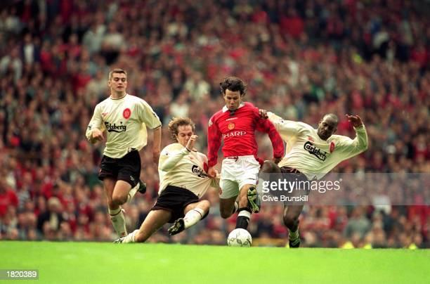 Ryan Giggs of Manchester United uses his skill and pace to take the ball past Jason McAteer and Michael Thomas of Liverpool during the FA Carling...