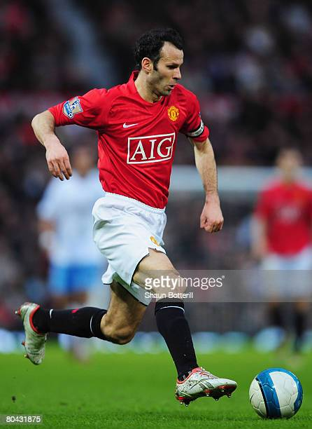 Ryan Giggs of ManUtd runs with the ball during the Barclays Premier League match between Manchester United and Aston Villa at Old Trafford on March...