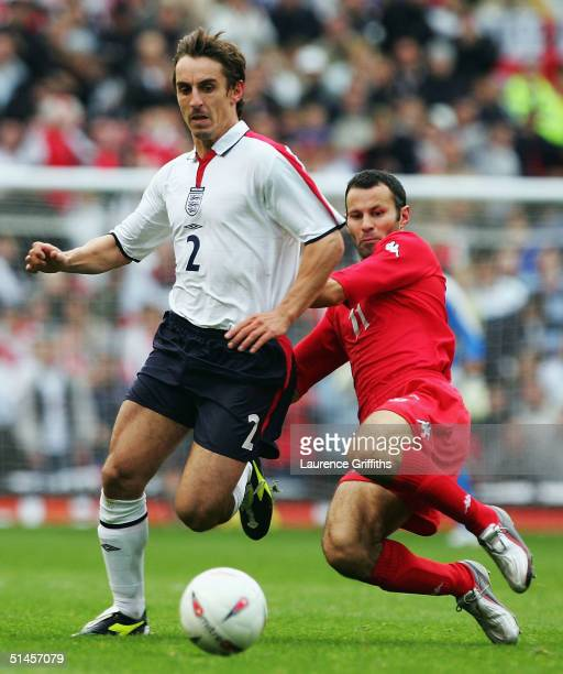 Ryan Giggs of Wales battles with Gary Neville of England during the 2006 World Cup Qualifying match between England and Wales at Ols Trafford on...