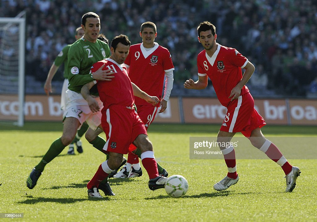 Ryan Giggs of Wales is challenged by John O'Shea of Ireland during the Euro2008 Group D Qualifier between the Republic of Ireland and Wales at the Croke Park Stadium on March 24, 2007 in Dublin, Ireland.