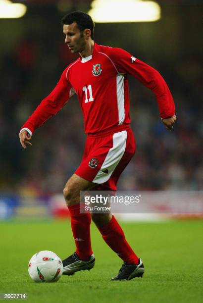 Ryan Giggs of Wales running with the ball during the European Championships 2004 group 9 qualifing match between Wales and Serbia and Montenegro at...