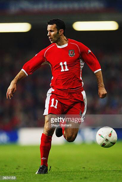 Ryan Giggs of Wales runs with the ball during the Euro 2004 group 9 qualifing match between Wales and Serbia Montenegro at the Millennium Stadium on...