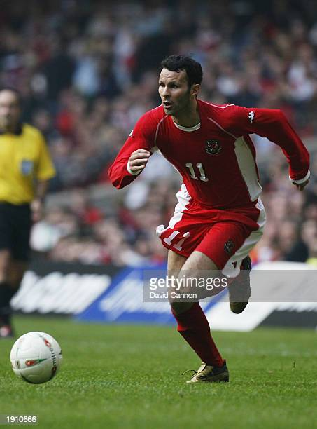 Ryan Giggs of Wales runs with the ball during the European Championships 2004 Group 9 Qualifying match between Wales and Azerbaijan held on March 29...