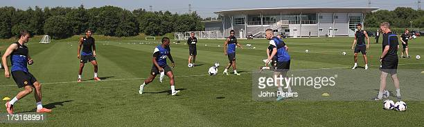Ryan Giggs, Patrice Evra, Jonny Evans and Tom Cleverley of Manchester United in action while Manager David Moyes watches on during a first team...