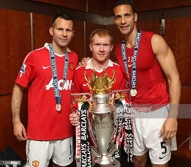 Ryan Giggs, Paul Scholes and Rio Ferdinand of Manchester United pose in the dressing room with the Barclays Premier League trophy after the Barclays...