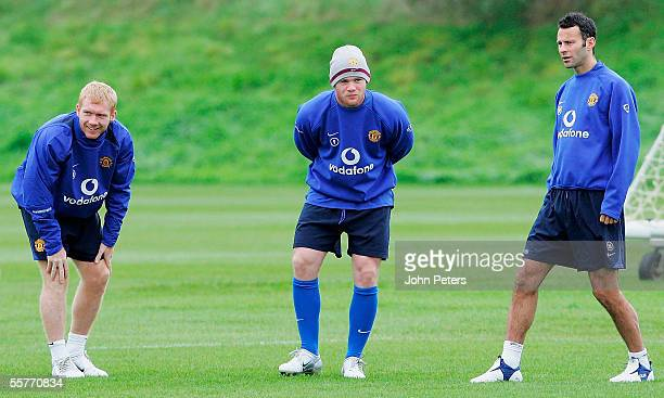 Ryan Giggs, Paul Scholes and Wayne Rooney of Manchester United in action during a first team training session at Carrington Training Ground on 26...