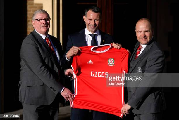 Ryan Giggs poses holding a Welsh shirt with David Griffiths President of the Football Association of Wales and Jonathan Ford Chief Executive Officer...
