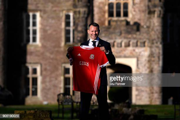 Ryan Giggs poses with a Welsh shirt after attending a press conference as he is announced as the new manager of Wales at Hensol Castle on January 15...