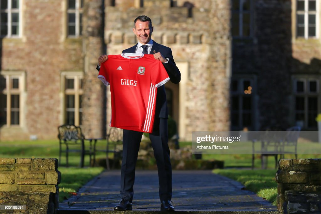 Ryan Giggs poses with a Welsh shirt after attending a press conference as he is announced as the new manager of Wales at Hensol Castle on January 15, 2018 in Cardiff, Wales.