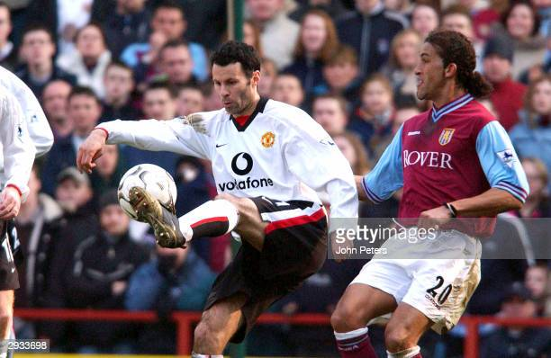 Ryan Giggs shields the ball from Aston Villa's Moustapha Hadji during the FA Barclaycard Premiership match between Aston Villa v Manchester United at...
