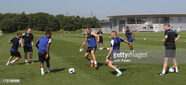 Ryan Giggs, Wayne Rooney, Patrice Evra, Jonny Evans and Tom Cleverley of Manchester United in action while Manager David Moyes watches on during a...