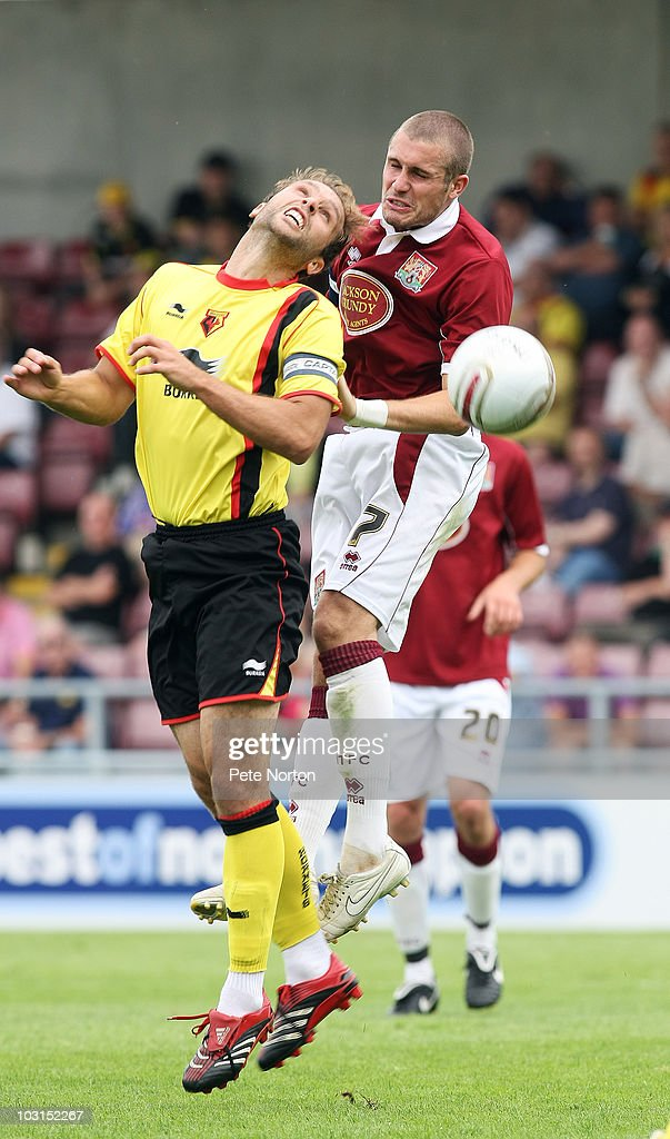 Ryan Gilligan of Northampton Town challenges for the ball with John Eustace of Watford during the pre season match between Northampton Town and Watford at Sixfields Stadium on July 24, 2010 in Northampton, England.