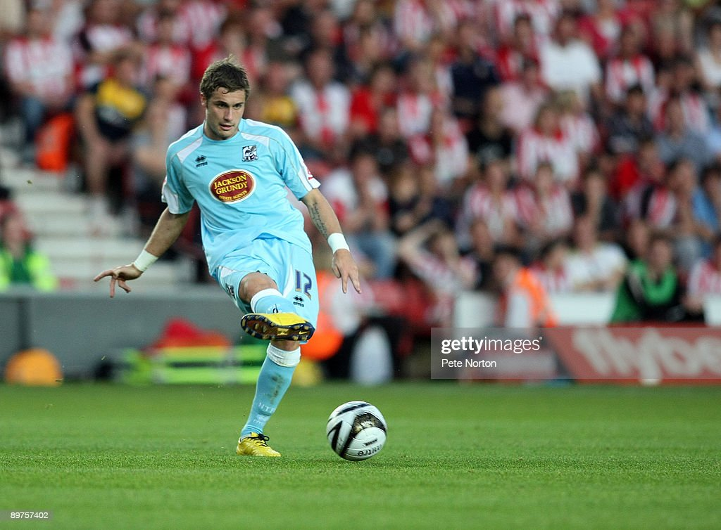 Ryan Gilligan of Northampton Town passes the ball during the Carling Cup Round One Match between Southampton and Northampton Town at St Mary's Stadium on August 11, 2009 in Southampton, England. Southampton won the match 2-0.