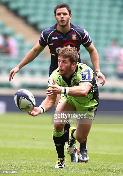 Ryan Glynn of Northampton Saints passes the ball in the match against Buenos Aires during the World Club 7's at Twickenham Stadium on August 17 2013...