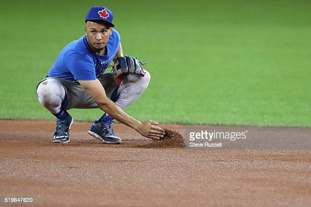 Ryan Goins examines the infield dirt at second base as the Toronto Blue Jays practice on the eve of their home opener against the Boston Red Sox at...