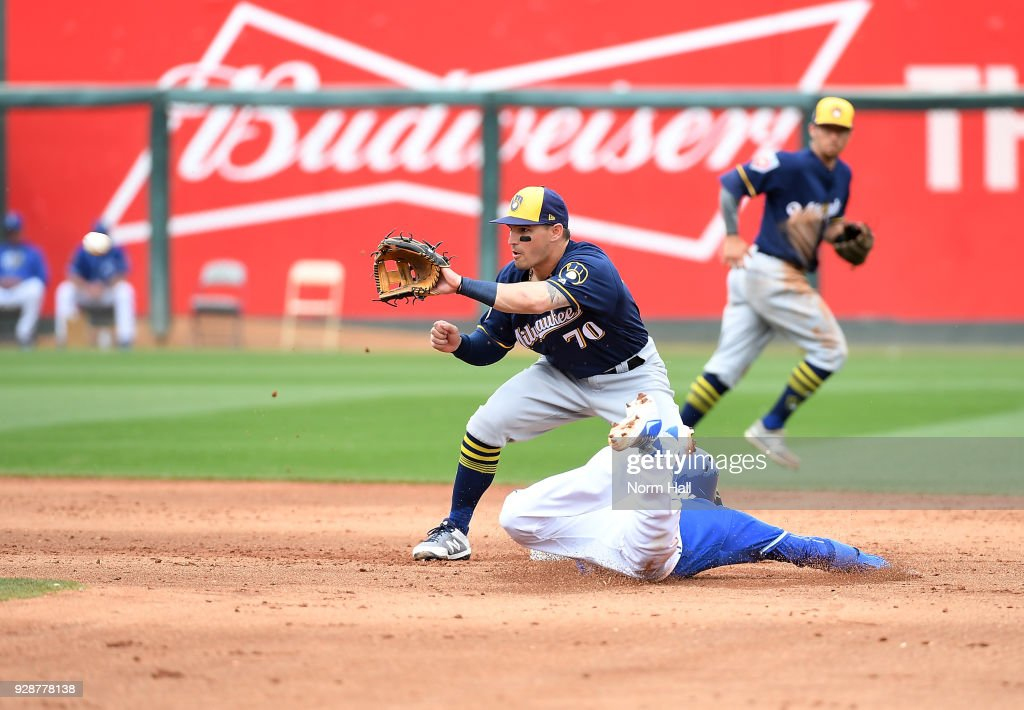 Ryan Goins #1 of the Kansas City Royals attempts to steal second base as Nate Orf #70 of the Milwaukee Brewers waits for the throw from catcher Christian Bethancourt #29 during the fourth inning of a spring training game at Surprise Stadium on March 7, 2018 in Surprise, Arizona. Goins was called out at second base.