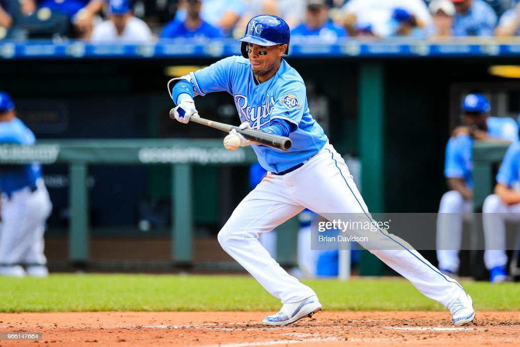 Ryan Goins #1 of the Kansas City Royals bunts the ball during the fourth inning against the Oakland Athletics at Kauffman Stadium on June 2, 2018 in Kansas City, Missouri.
