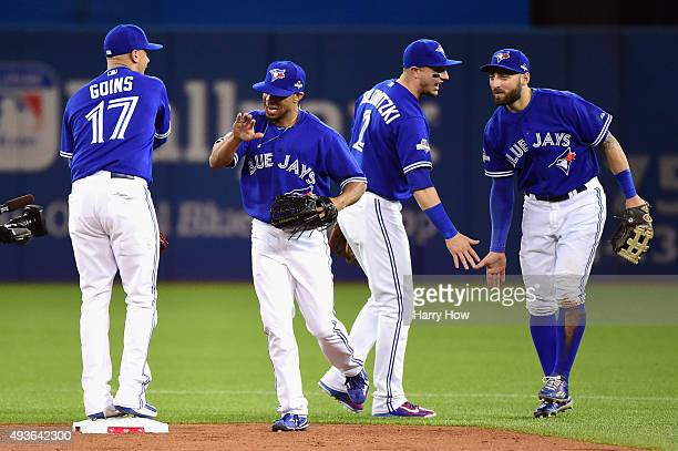 Ryan Goins of the Toronto Blue Jays Ben Revere of the Toronto Blue Jays Troy Tulowitzki of the Toronto Blue Jays and Kevin Pillar of the Toronto Blue...