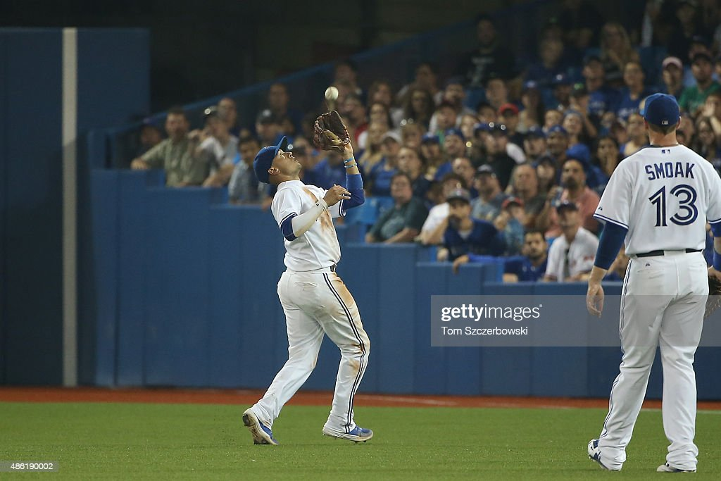 Ryan Goins #17 of the Toronto Blue Jays catches a pop up in the fifth inning during MLB game action against the Cleveland Indians on September 1, 2015 at Rogers Centre in Toronto, Ontario, Canada.