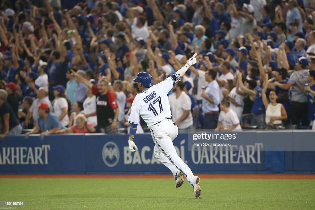 Ryan Goins #17 of the Toronto Blue Jays celebrates as he hits a game-winning two-run home run in the tenth inning during MLB game action against the Cleveland Indians on September 1, 2015 at Rogers Centre in Toronto, Ontario, Canada.