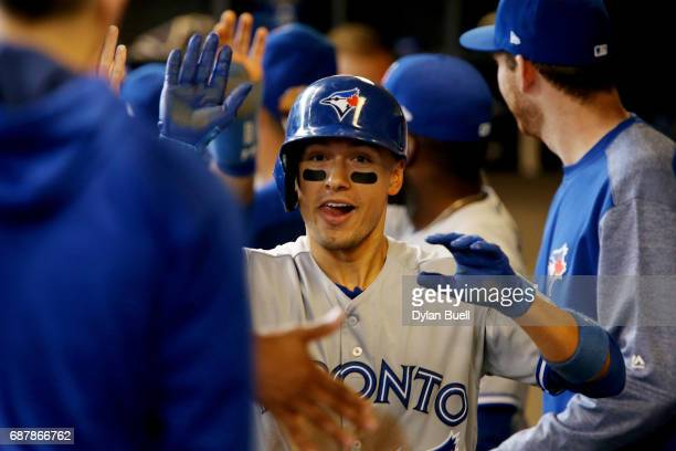 Ryan Goins of the Toronto Blue Jays celebrates with teammates after hitting a grand slam in the sixth inning against the Milwaukee Brewers at Miller...