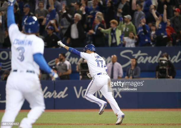 Ryan Goins of the Toronto Blue Jays is celebartes as he hits a gamewinning RBI single as Ezequiel Carrera jogs home to score the winning run in the...