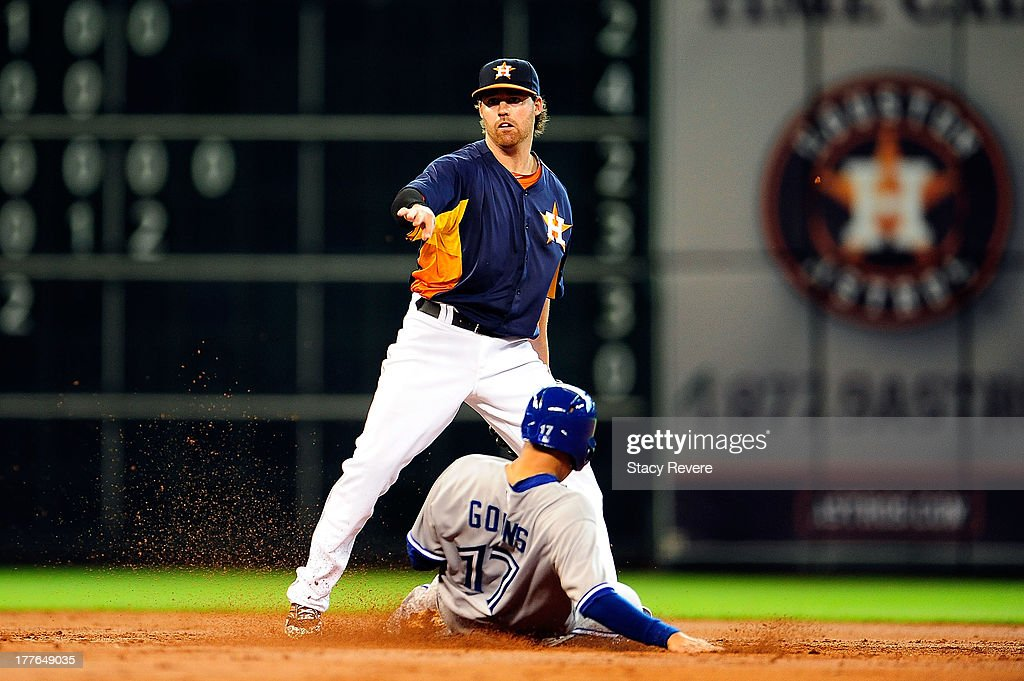 Ryan Goins #17 of the Toronto Blue Jays is put out at second base by Jake Elmore #10 in the third inning during a game at Minute Maid Park on August 25, 2013 in Houston, Texas.
