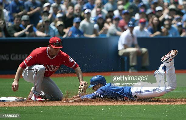 Ryan Goins of the Toronto Blue Jays is tagged out at third base trying to advance on a double by Josh Donaldson in the second inning during MLB game...