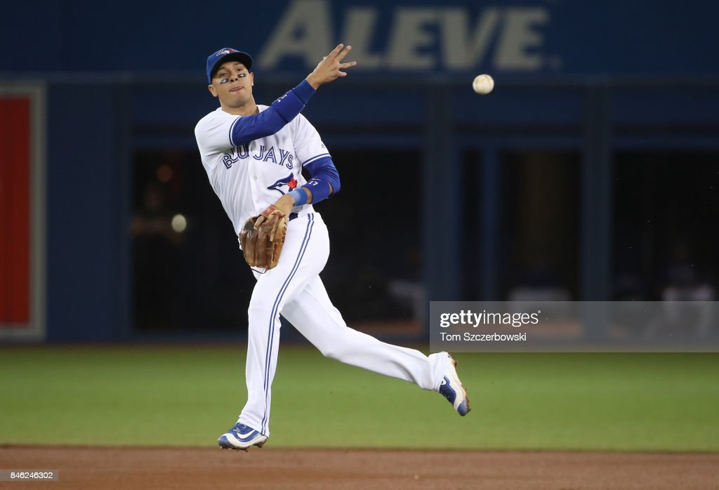 Ryan Goins #17 of the Toronto Blue Jays makes the play and throws out the baserunner in the fourth inning during MLB game action against the Baltimore Orioles at Rogers Centre on September 12, 2017 in Toronto, Canada.