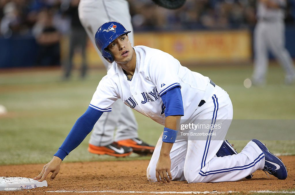 Ryan Goins #17 of the Toronto Blue Jays reacts after being picked off in the sixth inning during MLB game action against the Houston Astros on April 9, 2014 at Rogers Centre in Toronto, Ontario, Canada.