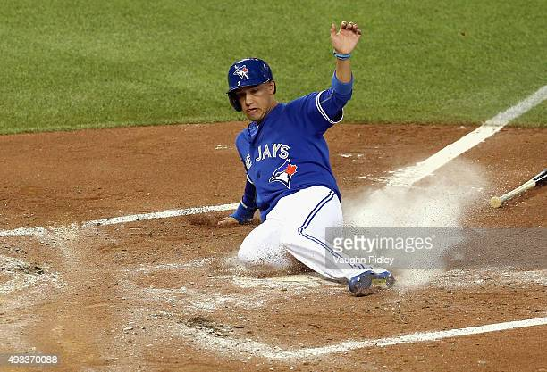 Ryan Goins of the Toronto Blue Jays scores a run in the second inning against the Kansas City Royals during game three of the American League...