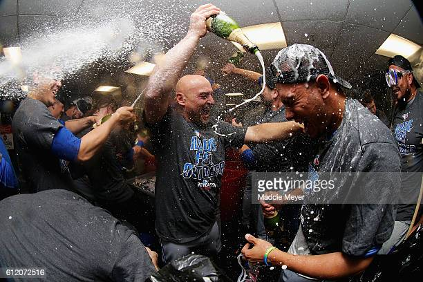 Ryan Goins of the Toronto Blue Jays sprays Ezequiel Carrera with champagne to celebrate their 21 win over the Boston Red Sox clinching a Wildcard...