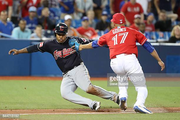 Ryan Goins tags out Jose Ramirez in an 18th inning run down as the Toronto Blue Jays lose the Cleveland Indians 2-1 in 19 innings on Canada Day at...