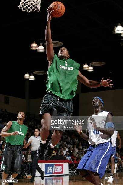 Ryan Gomes of the Boston Celtics goes for a layup against Pops MensahBonsu of the Dallas Mavericks during the 2006 Toshiba Vegas Summer League on...