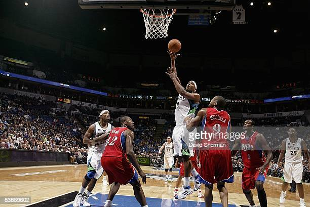 Ryan Gomes of the Minnesota Timberwolves puts up a shot between Elton Brand and Andre Iguodala of the Philadelphia 76ers during the game on November...