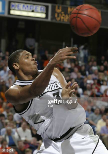 Ryan Gomes of the Providence Friars tries to keep the ball in bounds during the first round game of the NCAA Division I Men's Basketball Tournament...