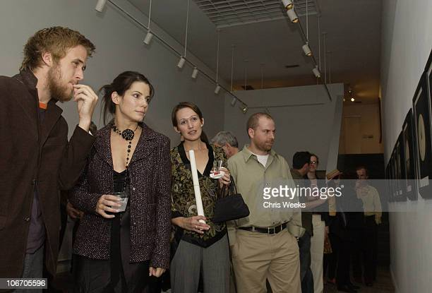Ryan Gosling and Sandra Bullock attend the artist's reception for photographer Dan Winters' gallery showing entitled 'La Ciudad' Saturday September...