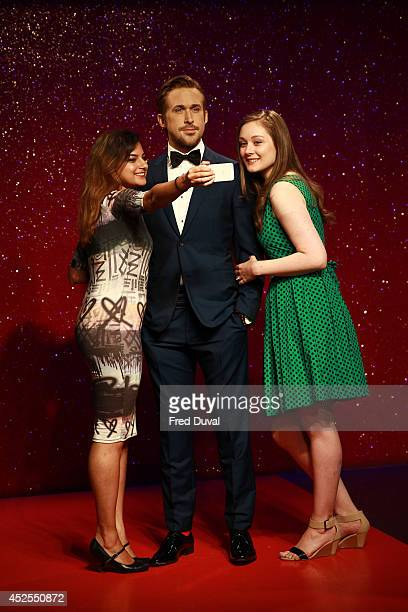 Ryan Gosling wax likeness with fans who are taking selfies as Madame Tussauds unveil their new Ryan Gosling wax figure at Madame Tussauds on July 23...